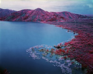 Richard Mosse, Lake formed by lava flow (on the right) in 2004, near Sake, North Kivu, Nov 2012.