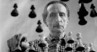 Marcel Duchamp playing chess