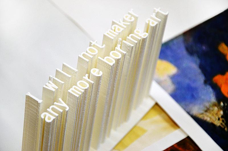 "Ashley Zelineskie's 3-D printed ""I Will Not Maker Any More Boring Art"". Eske Kath's new paintings. Bushwick Open Studios 2014. Photograph by Kristina Nazarevskaia"